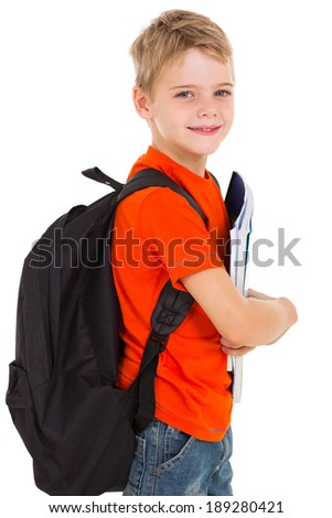 little schoolboy with schoolbag looking at the camera - stock photo