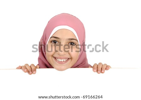 Little schoolgirl holding a blank white sign for your message. Good for borders of articles or websites. Beautiful arabic muslim model. Isolated on white background. - stock photo