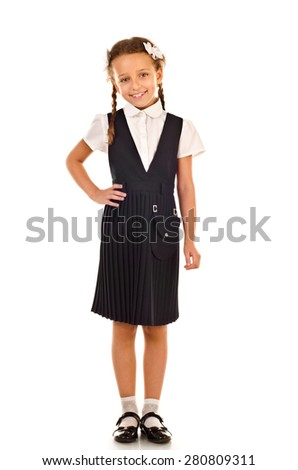 little schoolgirl isolated on a white background - stock photo