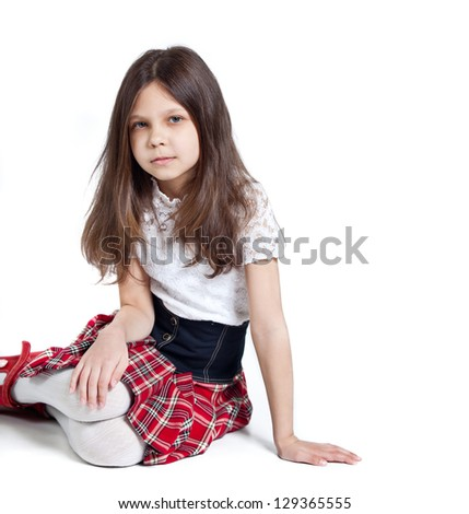 Little schoolgirl. isolated on white - stock photo