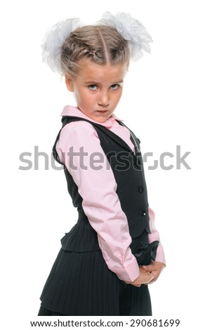 Little schoolgirl portrait in dress isolated on white - stock photo