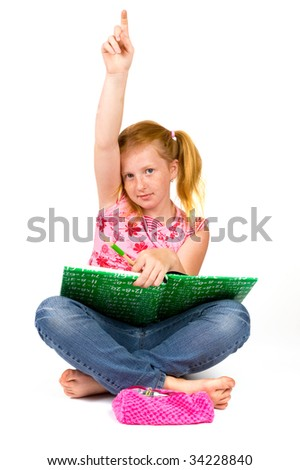 Little schoolgirl raised her hand to answer question isolated on white - stock photo