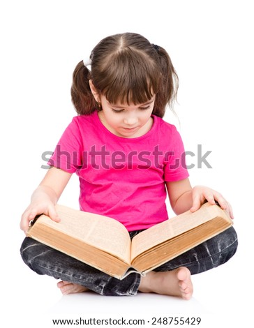 little schoolgirl reading big book. isolated on white background - stock photo