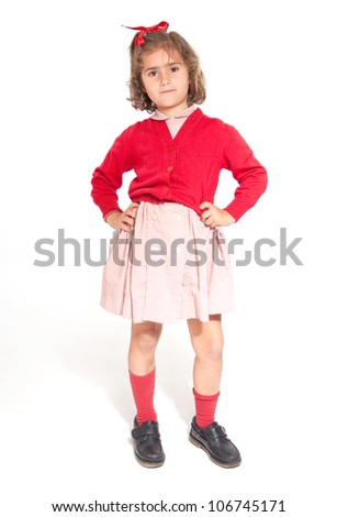 Little schoolgirl with a red uniform - stock photo