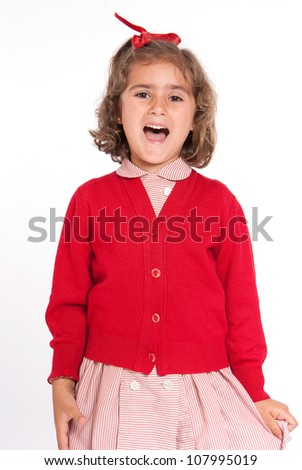 Little schoolgirl with a red uniform happily shouting - stock photo