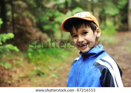 Little scouts in forest discovering nature - stock photo