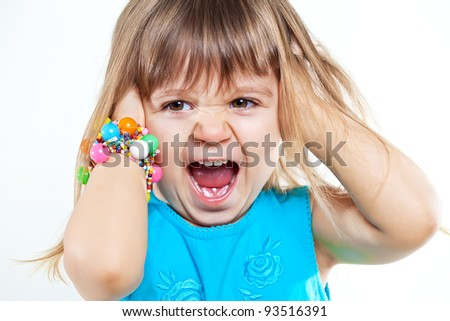 Little screaming girl with both eyes closed isolated over white background - stock photo