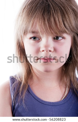 Little serious blonde girl - stock photo