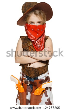Little serious girl wearing cowboy costume and bandana covering her mouth standing with folded hands, over white background - stock photo