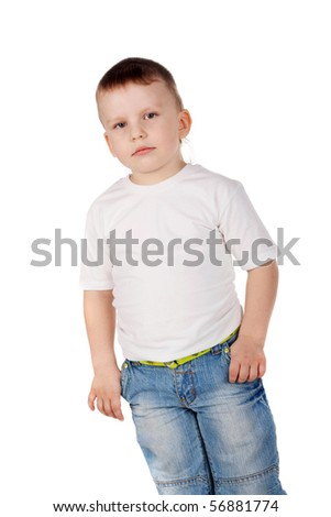 little serious kid in jeans - stock photo