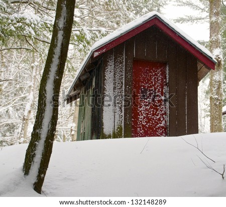 Little shed sits on top of the hill - stock photo
