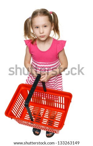 Little shopper. Little girl in full length holding empty shopping basket and thinking what gifts to buy, over white background - stock photo