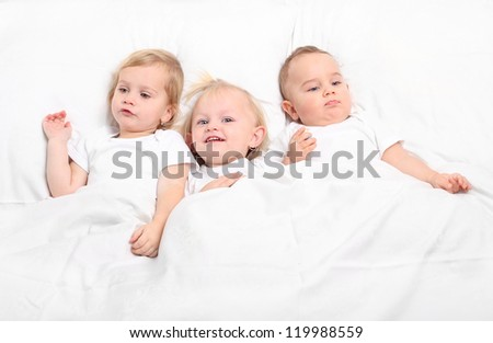 Little siblings in bed. Happy family concept.