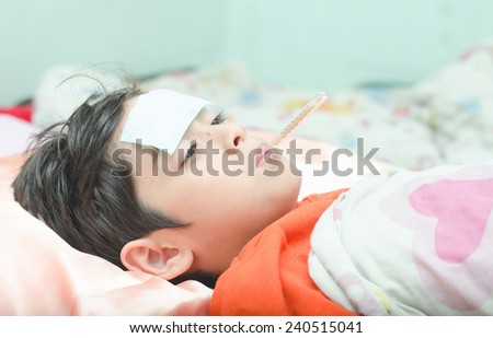 Little sick boy with temperature in mouth - stock photo