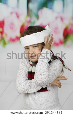 Little sick girl in headband has earache - stock photo
