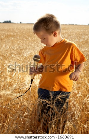 little singer at the field - stock photo