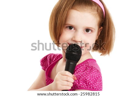 Little singer girl with microphone - stock photo