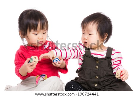 Little sister play together - stock photo