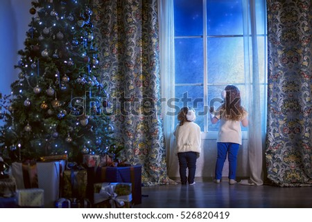 Little sisters awaiting Santa Claus