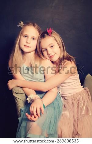 Little sisters girls hugging - stock photo