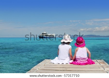 little sisters tourist turquoise sea back in Formentera - stock photo
