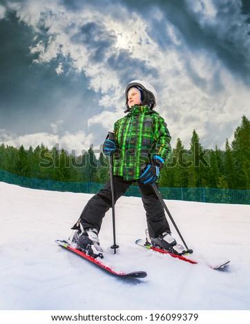 Little skier in mountain sky resort - stock photo