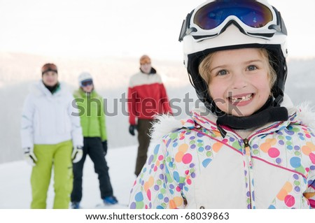 Little skier with family - stock photo