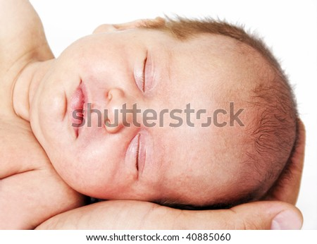 Little sleeping baby with head in daddy's hand - stock photo