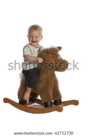 Little Smiling Baby Boy on Rocking Horse - stock photo