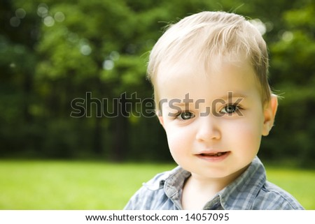 Little Smiling Baby On Natural Background - stock photo