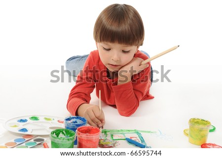 little smiling boy draws paint. Isolated on white background