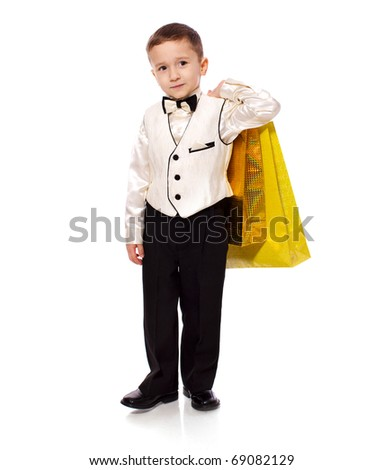 Little smiling Boy holding presents isolated on white