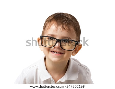 little  smiling boy in big glasses on white background - stock photo