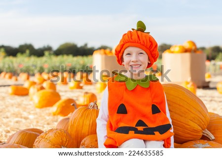 little smiling boy in pumpkin costume ready for halloween - stock photo