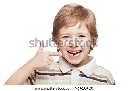 Little smiling child boy hand pointing his first baby milk or temporary tooth fall out