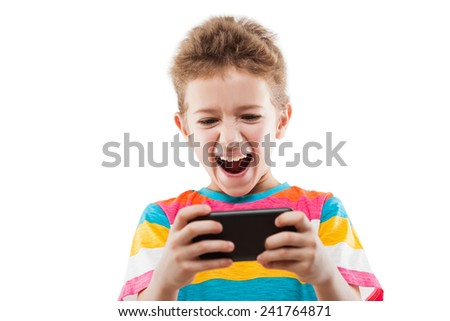 Little smiling child boy playing games or surfing internet on digital smartphone computer white isolated - stock photo