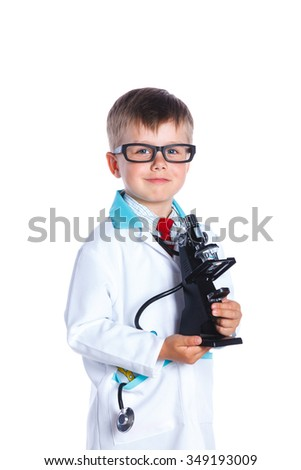 Little smiling doctor with stethoscope and microscope.. Isolated on white background - stock photo
