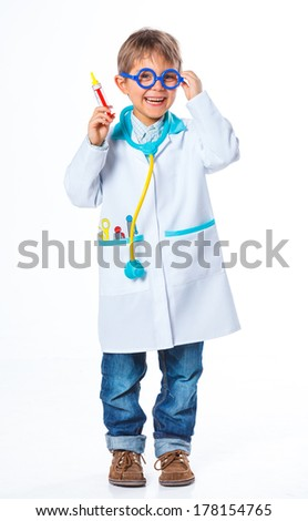 Little smiling doctor with stethoscope and syringe. Isolated on white background - stock photo