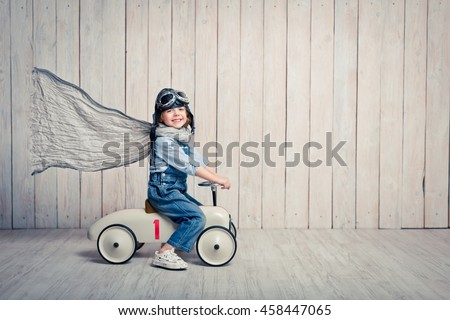 Little smiling driver in studio