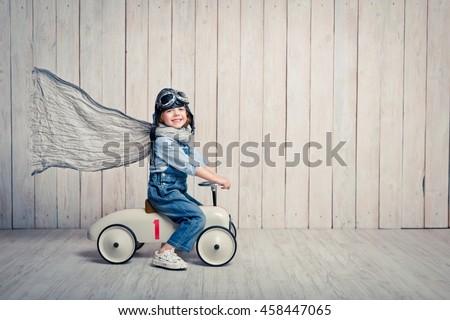 Little smiling driver in studio - stock photo