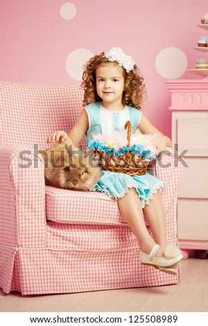 Little smiling easter girl with bunny - stock photo