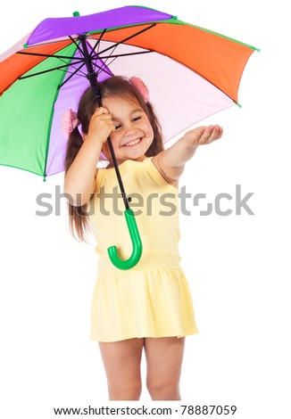 Little smiling girl holding colored umbrella and checking for rain - stock photo