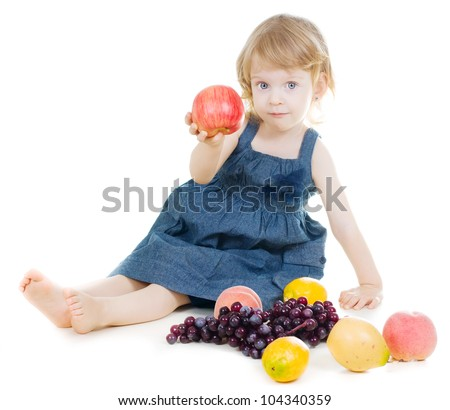 Little smiling girl holding red apple on white background - stock photo