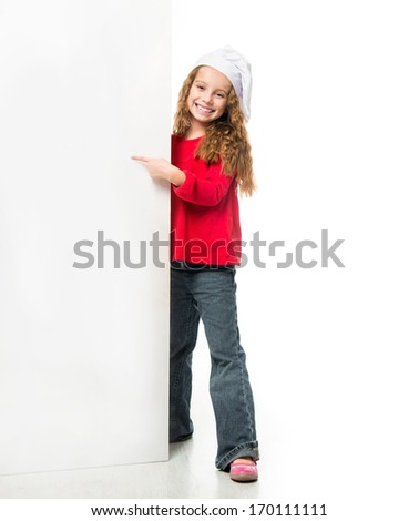 little smiling girl in chef hat with a white board - stock photo
