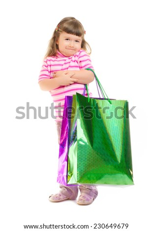 Little smiling girl with bags isolated - stock photo