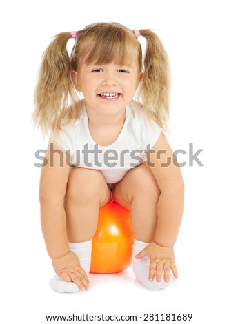Little smiling girl with ball isolated
