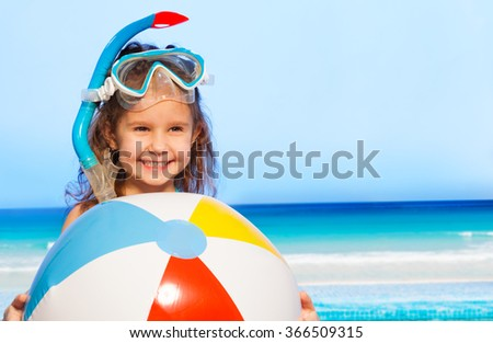 Little smiling girl with big inflatable ball - stock photo