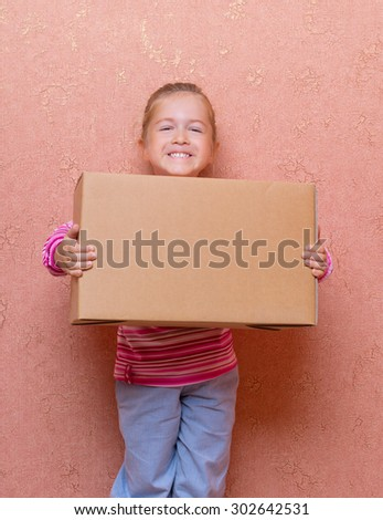 Little smiling girl with box - stock photo