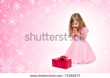 Little smiling girl with gift box
