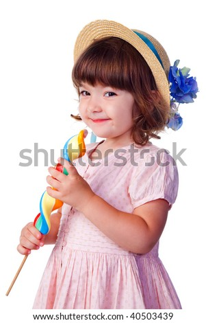 little smiling girl with lollipop